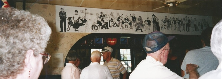 A mural made of the people at the angel inn
